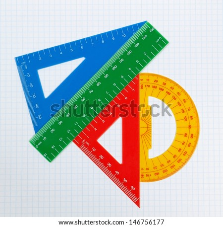 School drawing tools. Triangle, ruler, protractor. - stock photo