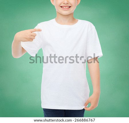 school, education, advertising, people and childhood concept - smiling little boy in white blank t-shirt pointing finger at himself over green chalk board background - stock photo