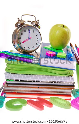 school equipment with alarm clock,books,notes,pencils and apple isolated on white - stock photo