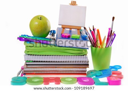 school equipment with color pencils ,ball pens,books,letters,apple and easel isolated on white - stock photo