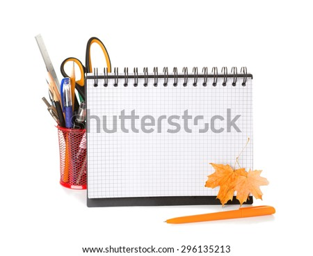 School equipment with pencils,   notebook  and  dry autumn leaves  isolated on white.   Back to school concept. - stock photo