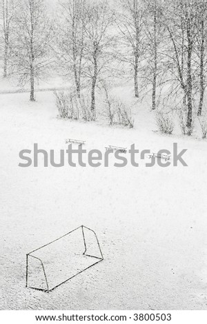 School football ground while snowfalling - stock photo