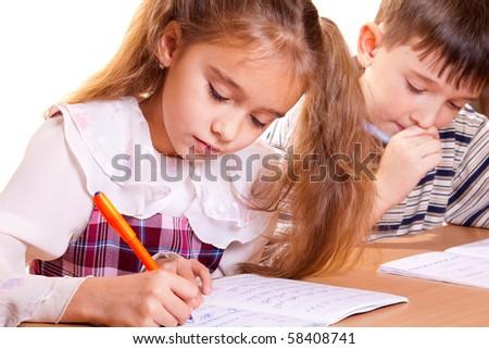 School Girl and Boy Doing Homework - stock photo