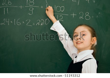 school girl finding solution and solving task on the  blackboard - stock photo