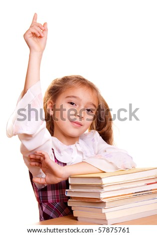 School girl hand raised for answer or question - stock photo