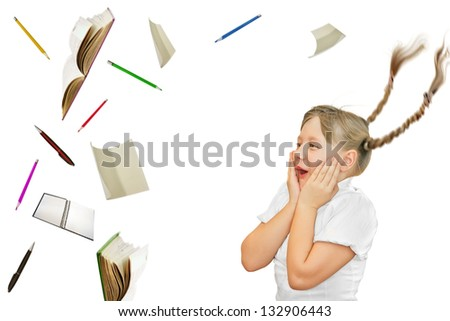 School girl looking surprised at school objects flying - stock photo