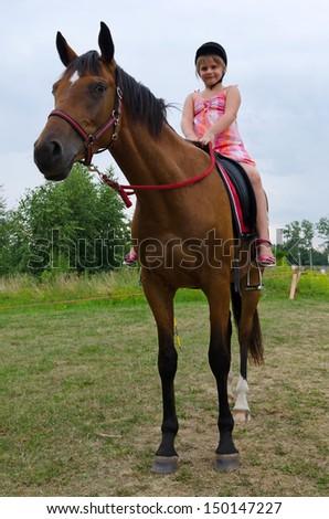 School girl on arabian horse - stock photo
