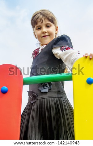 School Girl on the bridge - stock photo