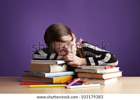 School Girl Sleeping on a Stack of Books - stock photo