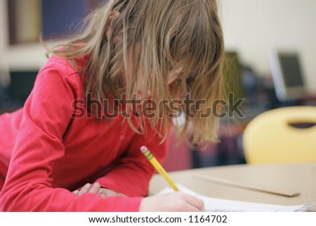 School girl writing - stock photo