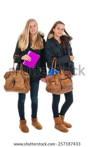 school girls walking at school with heavy school bags - stock photo