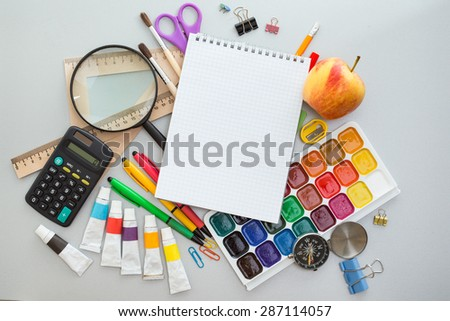 School items on the desk - stock photo