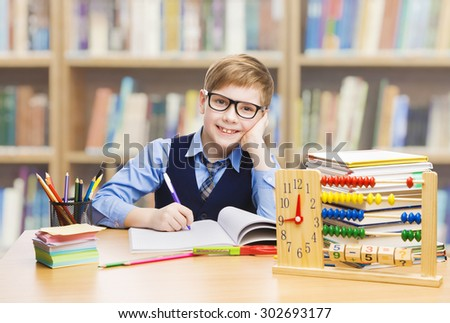 School Kid Education, Student Boy Studying Books, Little Child in Glasses, Abacus clock - stock photo