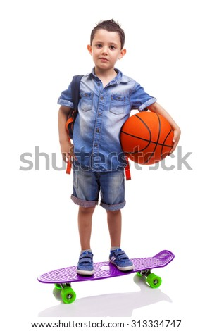 School kid holding a skateboard and a basketball on white background - stock photo