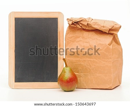 school lunch bag with blank blackboard on white - stock photo