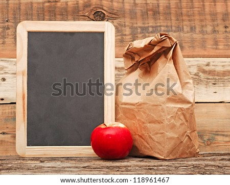 school lunch over blank blackboard - stock photo