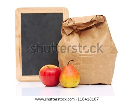 School lunch with fruit and black chalkboard ready for your text - stock photo