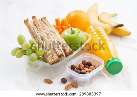 school lunch with sandwich on white table, close-up - stock photo