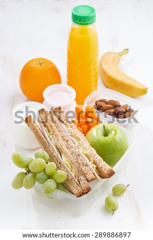 school lunch with sandwich, vertical, top view - stock photo