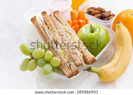 school lunch with sandwiches and fruit, close-up, horizontal - stock photo