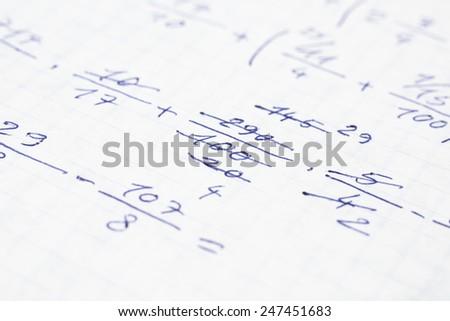 School Notebook With Handwritten Algebra Equations - stock photo