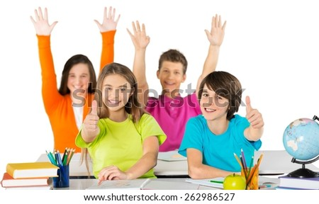 School. Students peeking behind pile of books on white background - stock photo