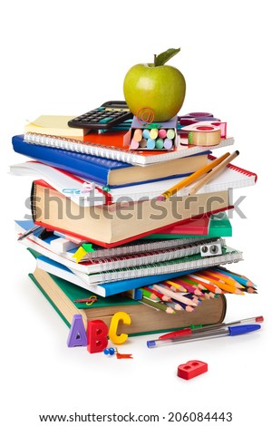 School supplies and green apple isolated on white background. - stock photo