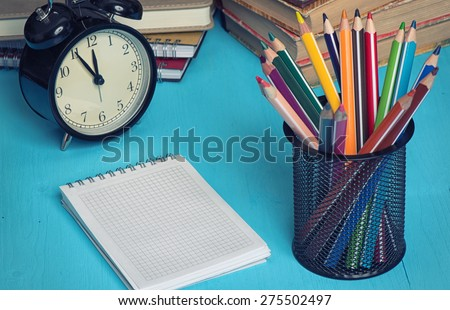 school supplies and notepad for copy space on a blue desk - stock photo