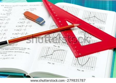 school supplies and textbooks on mathematics close up. Horizontal photo. - stock photo
