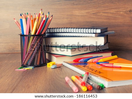 school supplies on a desk - stock photo