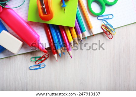 School supplies on desk, close-up - stock photo