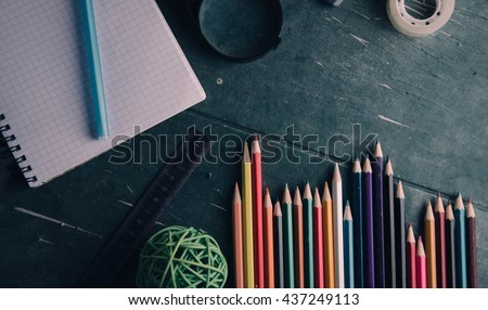 School supplies on old wooden table - stock photo