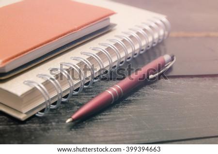 School supplies on wooden background - stock photo