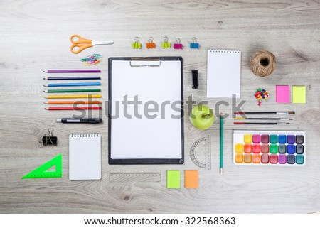 school supplies with pencils, paint pens paper scissors and rulers. - stock photo