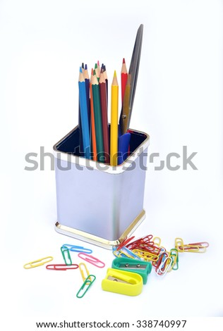 School supplies with sharpener and paper holders - stock photo