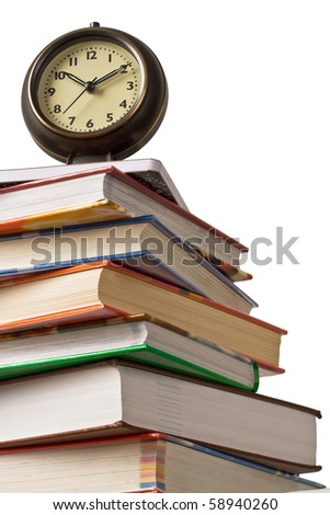School time. Alarm clock sitting on top of a stack of books.  Concept of education. - stock photo