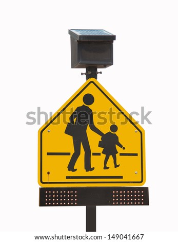 school traffic sign with Solar cells panel for Energy savings - stock photo