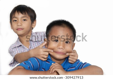 School two little boy making funny face - stock photo