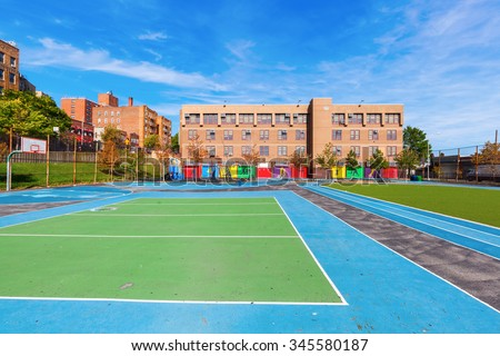school with playing field in the Bronx, New York City - stock photo