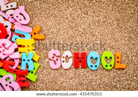School word of colorful letters on a wooden background - stock photo