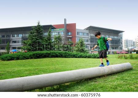 Schoolboy after school - stock photo