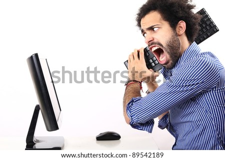 schoolboy behind his computer - stock photo