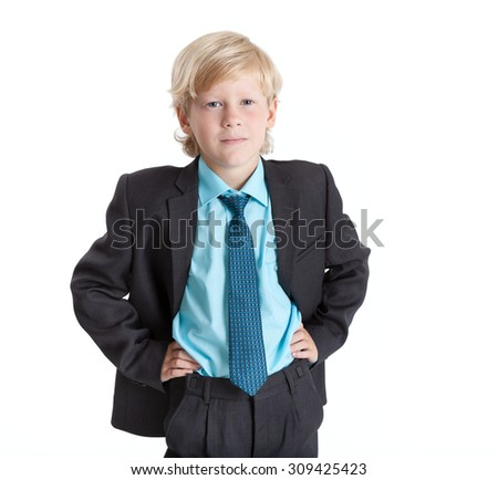 Schoolboy blond hair boy in school uniform, hands on hips, isolated on white background - stock photo