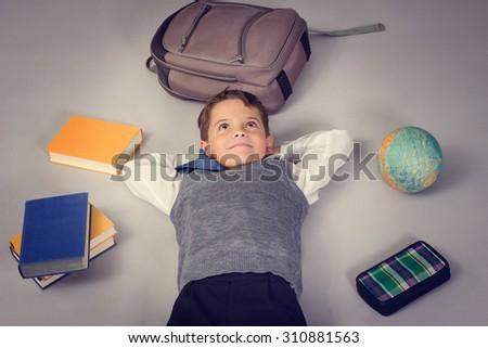 Schoolboy dreaming - stock photo