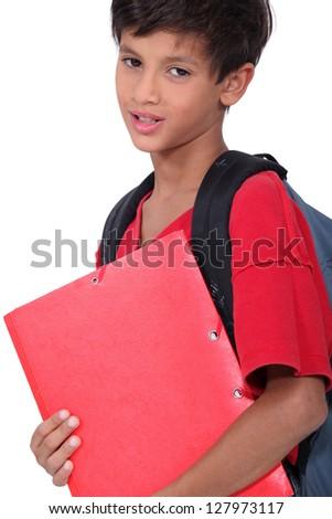 Schoolboy holding a folder - stock photo
