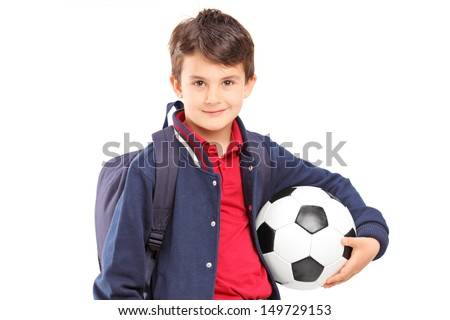 Schoolboy holding a soccer ball, isolated on white background - stock photo