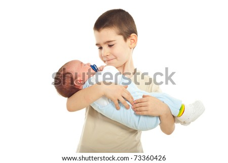 Schoolboy holding his newborn baby brother isolated on white background - stock photo