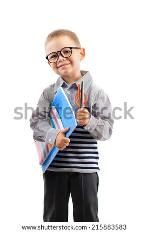 Schoolboy in glasses holding book,  isolated white background. Education and school concept - stock photo