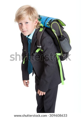 Schoolboy in uniform with heavy schoolbag, blond Caucasian boy, isolated on white background - stock photo