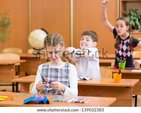 schoolboy indulging at lesson - stock photo